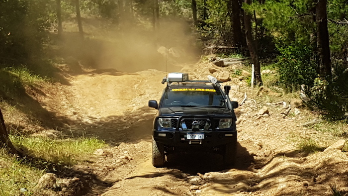 Paul and Lauren in their Navara on the longest climb of the day.
