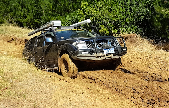 Paul drives his Navara out of the trench.