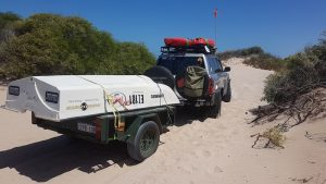 Towing the trailer through the dunes to the beach.