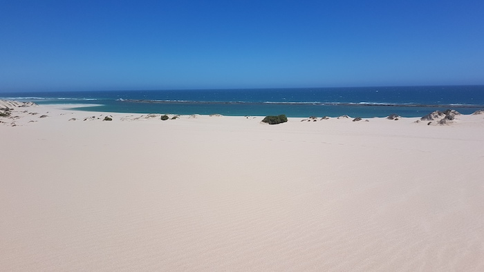 The extent of the fringing reef can be seen from the top of the dunes.