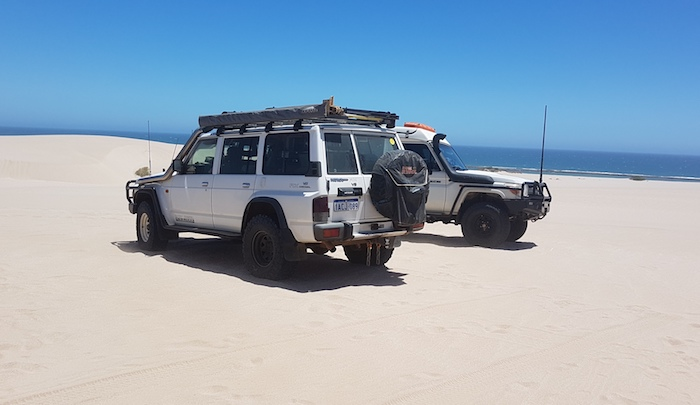 Matt and Tania in the GQ and Brad and Julie in the Troopy on top of Lucky Bay dunes.