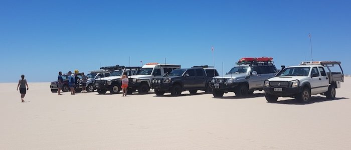 Vehicle lineup in the Lucky Bay dunes.