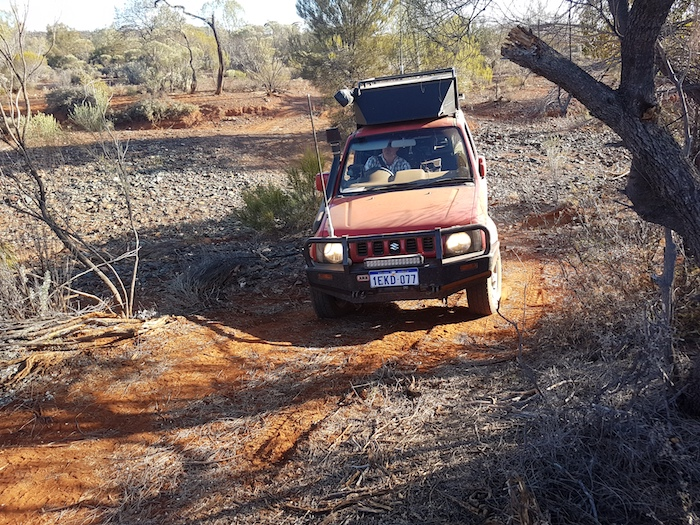Scott takes his well-travelled Jimny across the creek.