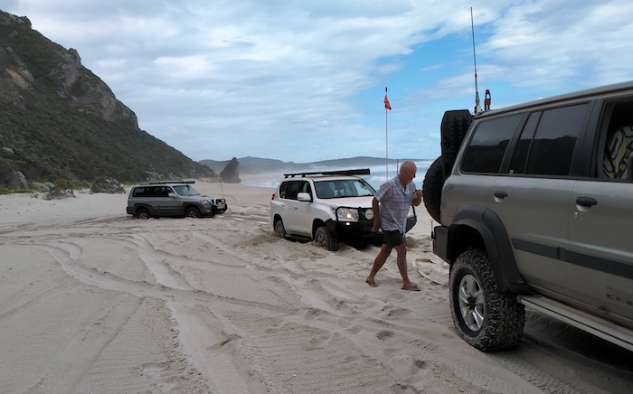 Scott prepares to tow out Graham and John at the top end of Bellanger Beach.