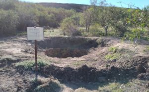 The soil removed from the well was used to repair the bunding where it had been eroded.
