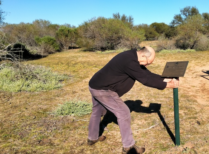 Gary tries to remove the incorrectly placed Bicentennial plaque at Karolin Rock.