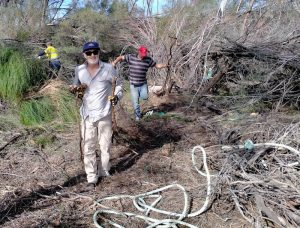 Rob and Andrew clearing away logs and sticks.